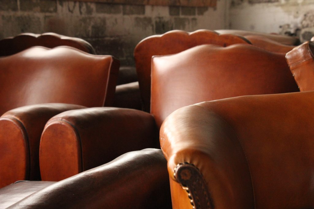 Some moustache and flower-shaped back vintage club armchairs that have been renovated with great care in our leather workshop in Callac, Brittany, l'Atelier du cuir - Bretagne.