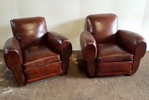 Paire de fauteuils club cuir ancien